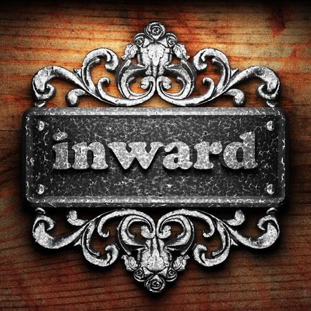 inward: Silver word on ornament