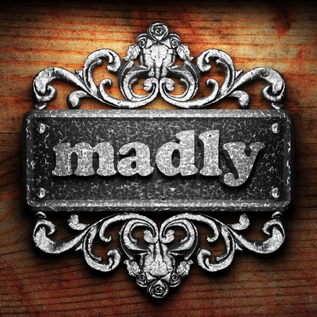 madly: Silver word on ornament