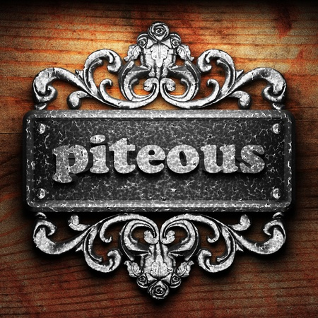 piteous: Silver word on ornament