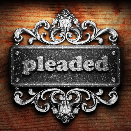 pleaded: Silver word on ornament