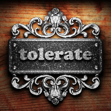 tolerate: Silver word on ornament
