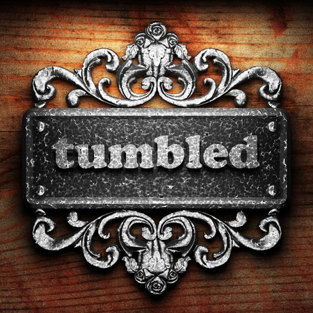 tumbled: Silver word on ornament