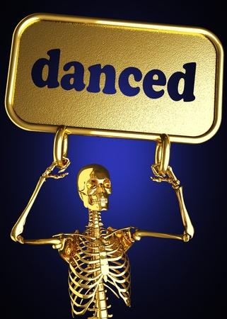 danced: Golden skeleton holding the sign made in 3D