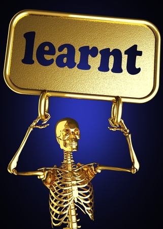 learnt: Golden skeleton holding the sign made in 3D