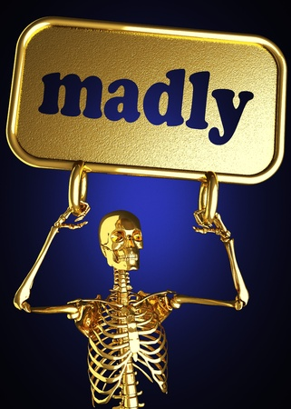 madly: Golden skeleton holding the sign made in 3D