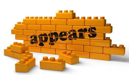 appears: Word on yellow wall Stock Photo