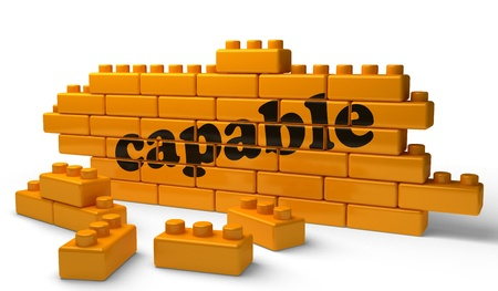 capable: Word on yellow wall Stock Photo