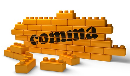 and comma: Word on yellow wall Stock Photo