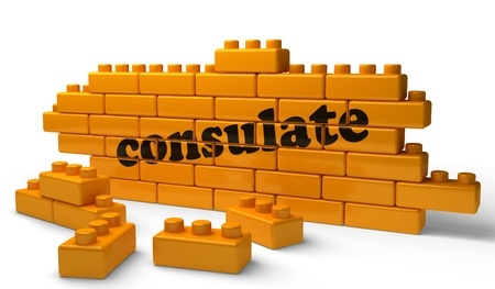 consulate: Word on yellow wall Stock Photo
