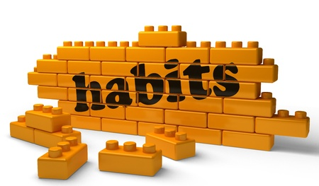 habits: Word on yellow wall Stock Photo