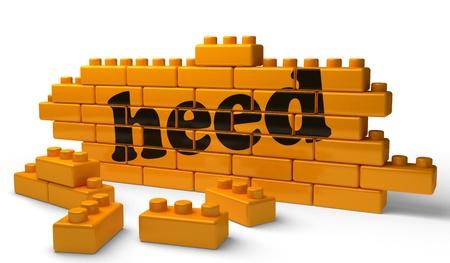 heed: Word on yellow wall Stock Photo