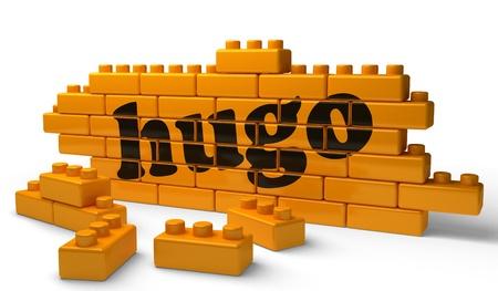 hugo: Word on yellow wall Stock Photo