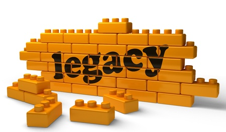 legacy: Word on yellow wall Stock Photo