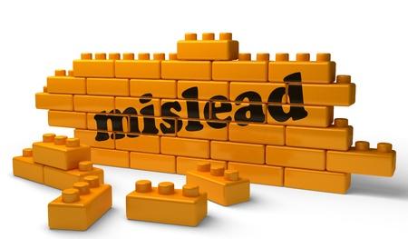 mislead: Word on yellow wall Stock Photo