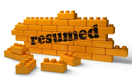 resumed: Word on yellow wall Stock Photo