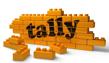 tally: Word on yellow wall Stock Photo