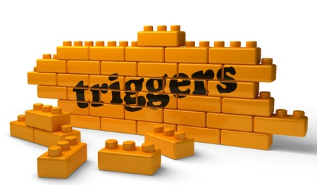 triggers: Word on yellow wall Stock Photo