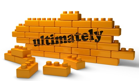 ultimately: Word on yellow wall Stock Photo