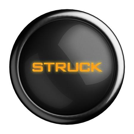 struck: Word on black button