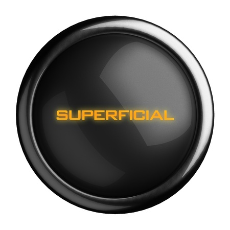superficial: Word on black button
