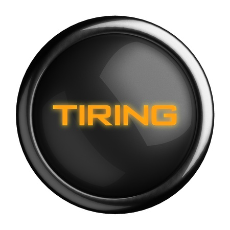 tiring: Word on black button