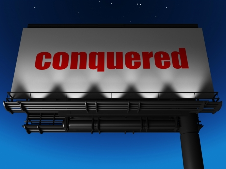 conquered: word on billboard