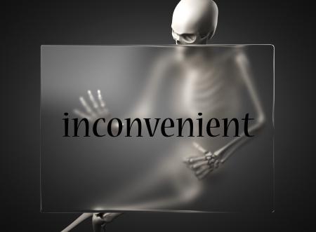 inconvenient: word on glass billboard