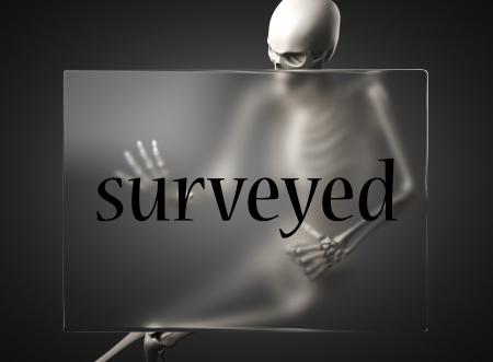 surveyed: word on glass billboard