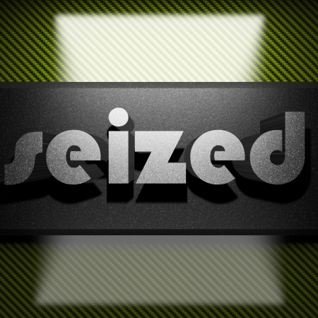 seized: metal word on carbon