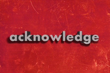 acknowledge: gray word on red wall