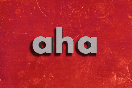 aha: gray word on red wall