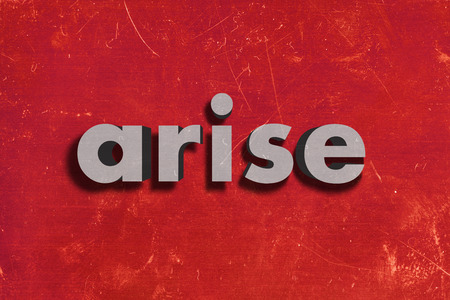 arise: gray word on red wall
