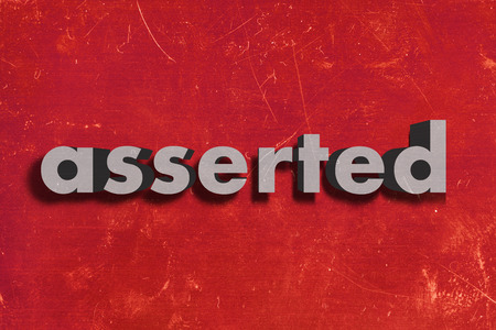 asserted: gray word on red wall