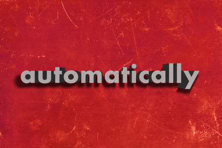 automatically: gray word on red wall
