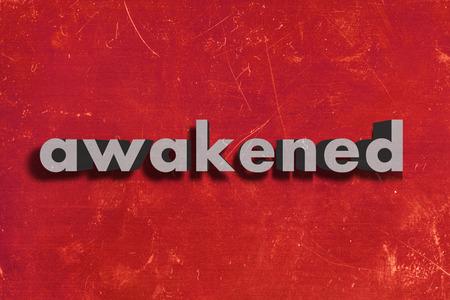 awakened: gray word on red wall