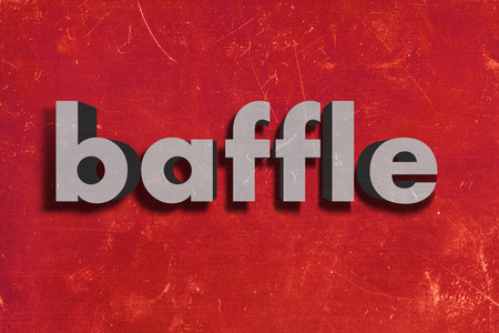 baffle: gray word on red wall