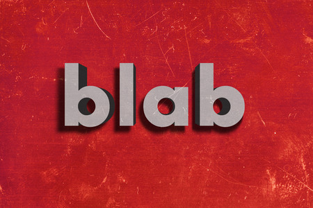 blab: gray word on red wall