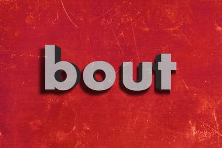 bout: palabra gris en la pared roja
