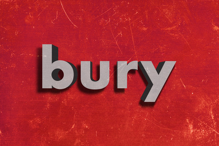 bury: gray word on red wall