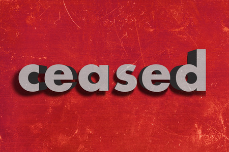 ceased: gray word on red wall