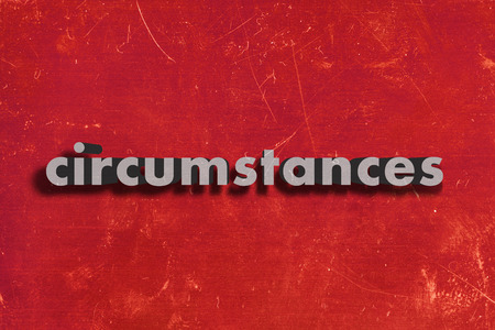the circumstances: gray word on red wall