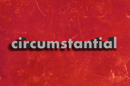circumstantial: gray word on red wall