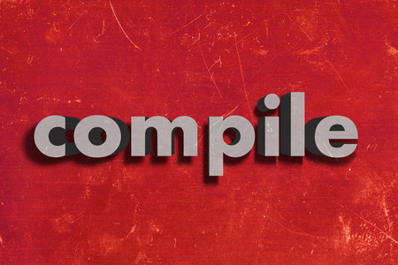 compile: gray word on red wall