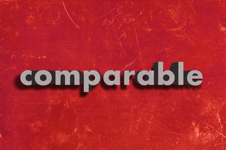 comparable: gray word on red wall