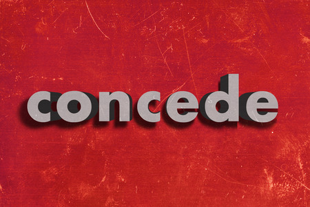 concede: gray word on red wall