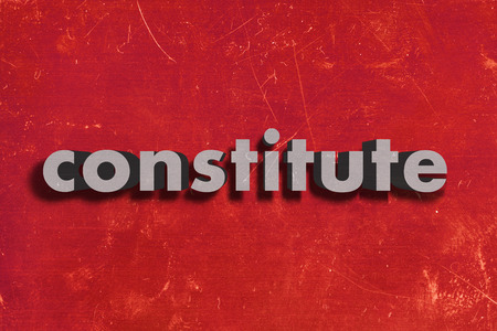 constitute: gray word on red wall