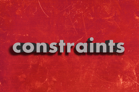 constraints: gray word on red wall