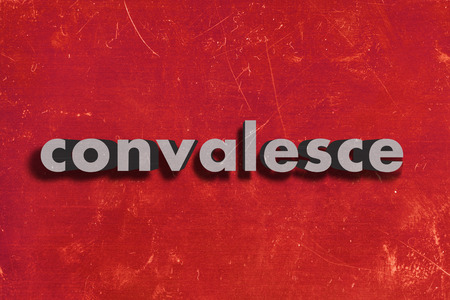 convalesce: gray word on red wall