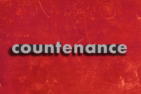 countenance: gray word on red wall