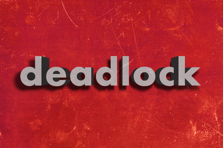 deadlock: gray word on red wall